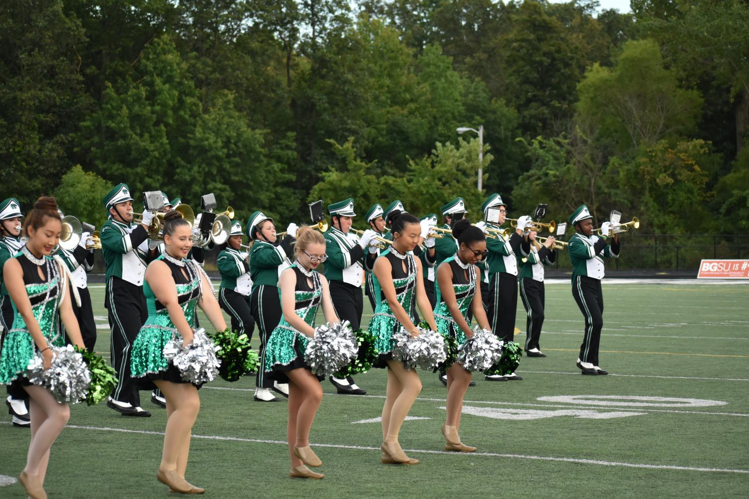 Under the leadership of Daisha Levy, the auxiliary team performs in the home opener in August.