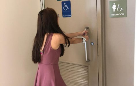 Senior Heidi Ngo struggles to open the door to the locked bathroom by the cafeteria, leaving only two available restrooms on the first floor.