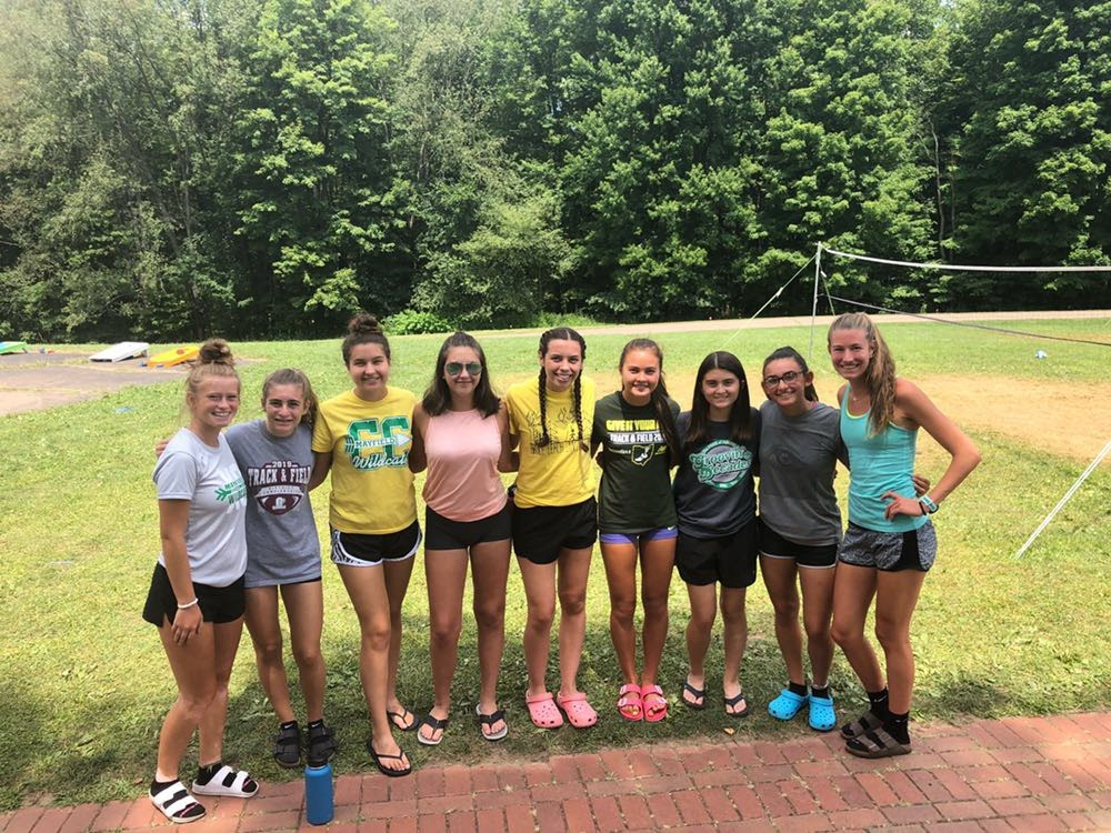 The girls were all smiles after attending a camp taught by accomplished college runners.