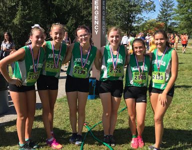 Cross country team runs towards districts