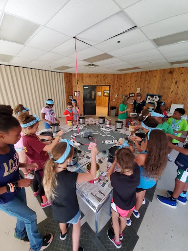 The counselors spent their time at Camp Fitch leading and participating in various activities, such as candle making with the kids.
