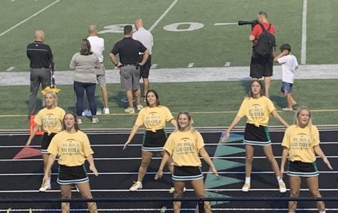 The cheerleaders wear their St. Jude shirts on the sidelines at the annual St. Jude fundraiser game.