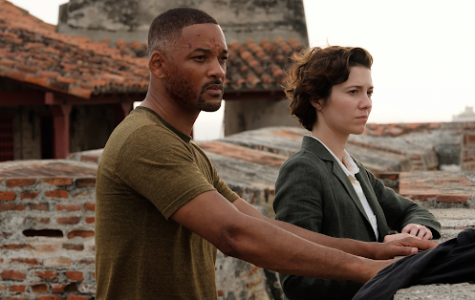 Henry (Will Smith) and his sidekick Danny (Mary Elizabeth Winstead) assess their surroundings in a scene from