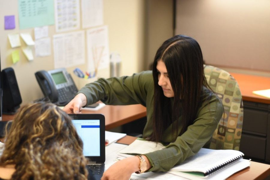 Hannah Grazia, the new 12th grade counselor, meets with a student during 4th period.