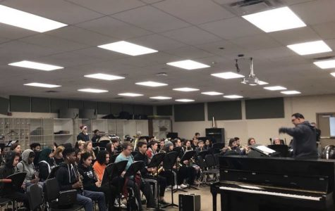 Mike Palermo instructs the band during class on Friday, Feb. 21.  Each band has spent the last two months working to prepare for the winter band concert, which takes place in early March.