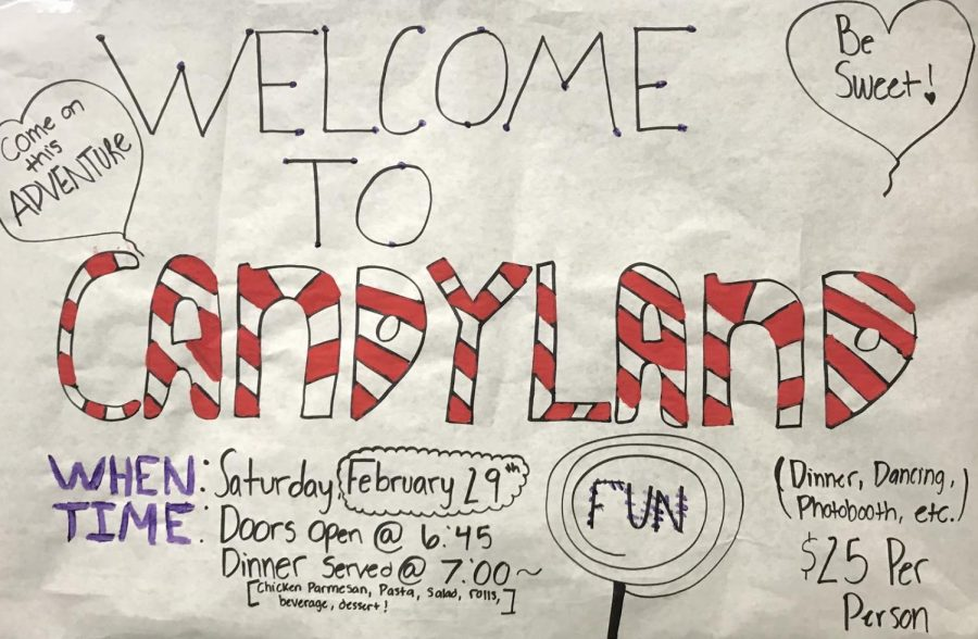 A+Night+in+Candyland%3A+Cats+Cabinet+has+made+posters+advertising+the+Feb.+29+dance+that+are+hung+all+over+the+school.