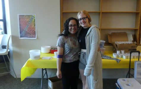 Seniors Haneen Hamideh and Cristy Eustace take a moment to enjoy the snack table after donating blood.