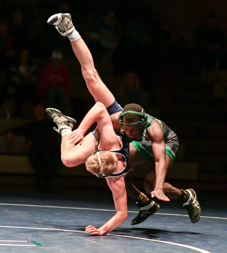 """TAKE DOWN Mayfield wrestler Greg Siambo slams an airborne opponent down during a tournament. """"I am very competitive against others. Its the only way to get better,"""" he said."""