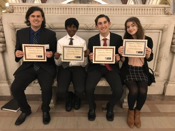 After winning Best Witness and Best Attorney at both their trials, Johhny Gaudio, Nick Korzhiletsky, Abhi Siri, and Emily Kolominsky pose for a picture with their awards.