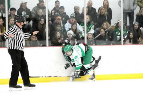 OUCH! Gavin Anselmo takes a big hit against the glass during the team