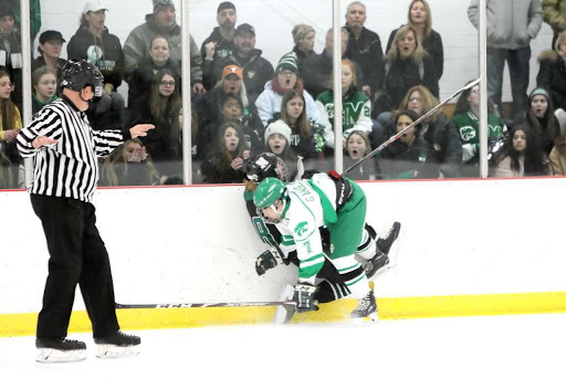 OUCH! Gavin Anselmo takes a big hit against the glass during the team's game versus Nordonia.