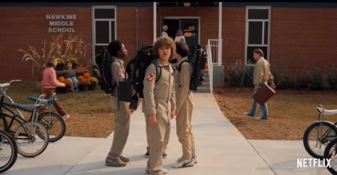 Dustin Henderson and his friends dress up as Ghostbusters for Halloween at school.