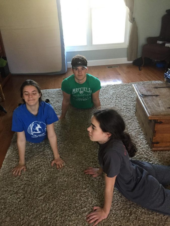 Senior+Joe+Isabella+%28center%29+does+yoga+with+two+of+his+sisters.