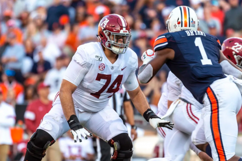 BIG BLOCKER: Jedrick Wills Jr, 74, blocks an Auburn defensive lineman in a game last season. Wills was the 10th pick in the 2020 NFL Draft and will play for the Cleveland Browns this fall.