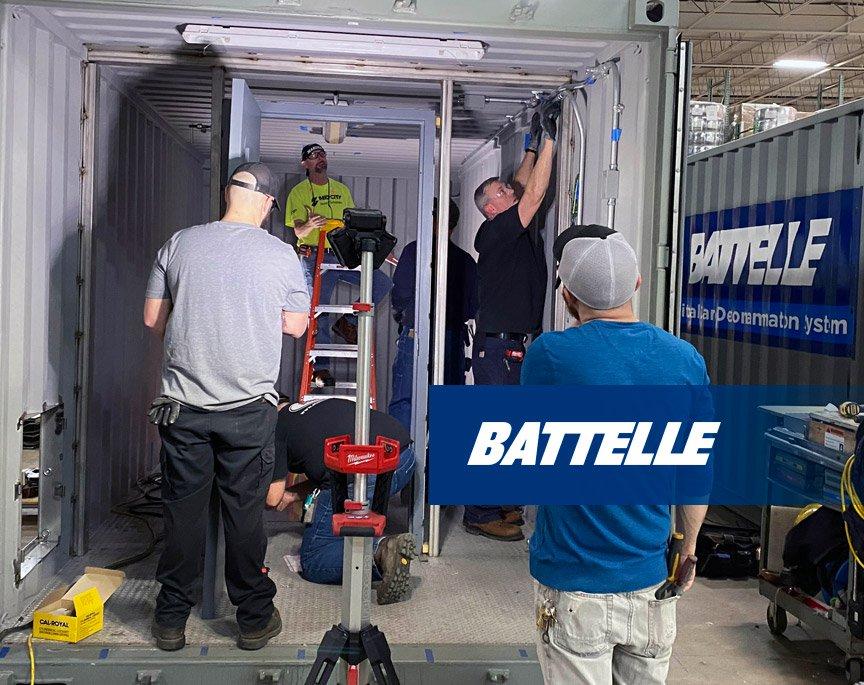 Battelle employees build a Battelle CCDS Critical Care Decontamination System™