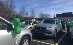"""Alexis Glumm, Larry Braun, Andi Cerrillo, and Danielle Varanese decorate cars in preparation for the parade. """"The day of, we all gathered at the Innovation Center parking lot beforehand to decorate our cars with balloons and streamers,"""" said Darcy Horvat."""