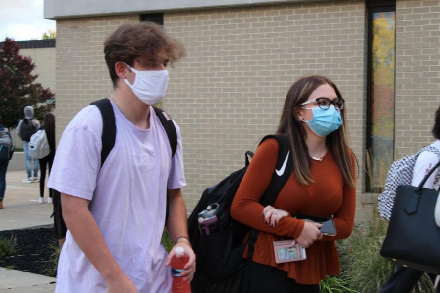 Mask Up!  Senior Chris Capuozzo and students in grades 10-12 walk into the building last Monday for the first time since March.  However, many students fear that the school will shut down.  Senior Kyla Chercourt said,