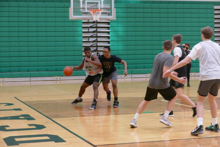 Junior Noah Adams competes in a pre-season practice with his teammates.