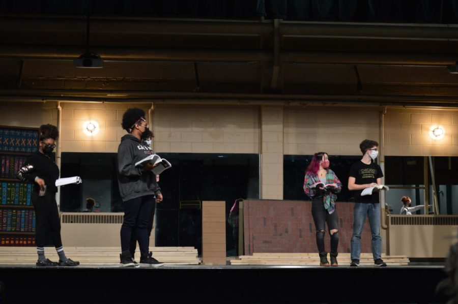 """The Show Must Go On: Members of the cast rehearse while staying socially distanced.  """"We are focusing on getting all of the different components together, and our cast and crew are hard at work memorizing lines and blocking. Our parent volunteers are an absolute life line in helping build the set and sewing the puppets,"""" said assistant director Jenny Walker."""