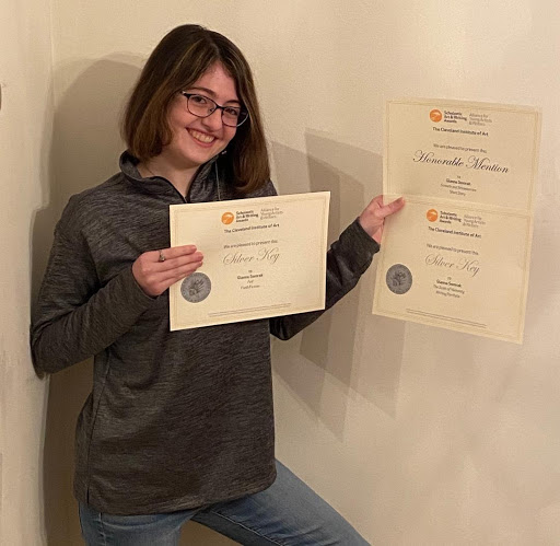 "Senior Gianna Somrak believes the hard work she put into writing and editing her creative writing paid off, as she won multiple awards.  Her teacher, Mrs. Kari Beery, admires Somrak's ability to open herself up to the ""possibilities of her work.""  Beery said, ""Her pacing, mix of rhyme and free verse, bountiful alliteration, and vivid imagery have you rereading her pieces over and over again and aloud to experience her craft."