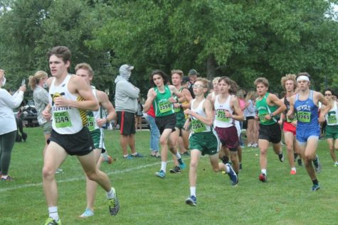Seniors Max Rollins and Ben Bremec compete against other boys in a cross country race in the fall.
