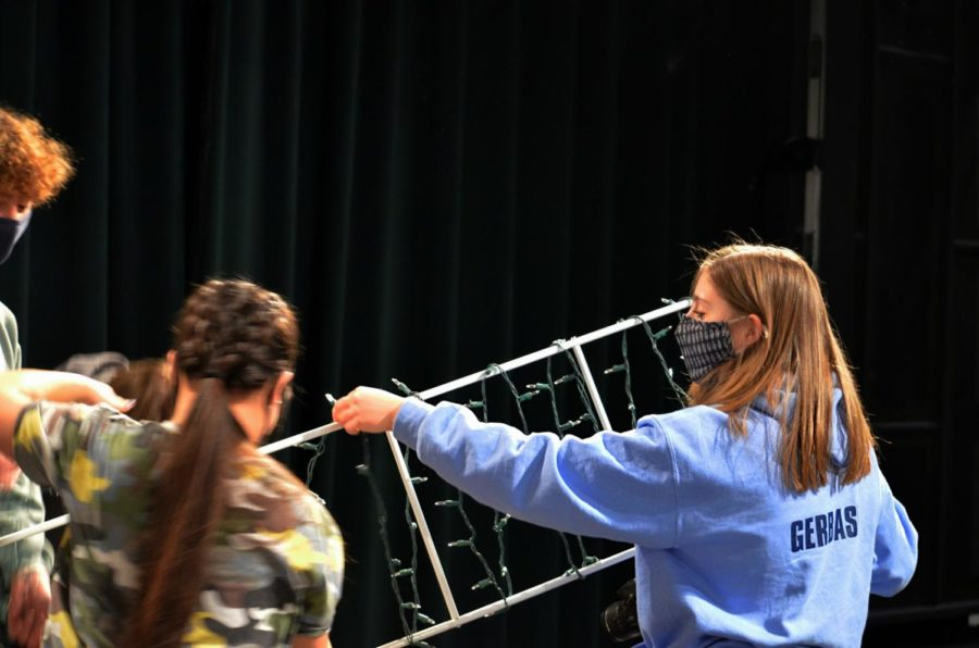 Junior class president, Nadia Gerbasi, helps decorate for the Homecoming assembly that honored the Sweet Sixteen.  This is the only student council event so far in the 2020-2021 school year.