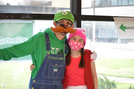 As part of the Senior Celebrity fundraiser, Johnny Gaudio and Alexis Ochi dress up as Mario Brothers characters.
