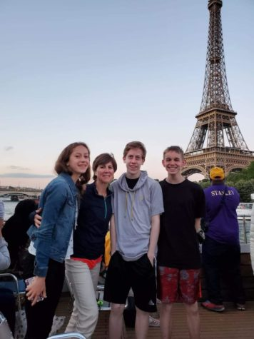 French Louise Vouk, second from the left, visits the Eiffel Tower with a group of students.