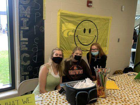 Madison Ferrell, Hannah Gross, and Natalie Purgar try to recruit students to join their club at the annual Club Fair.