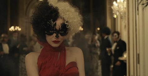 Cruella (Emma Stone) makes her first public appearance.  The movie is now available on Disney+.