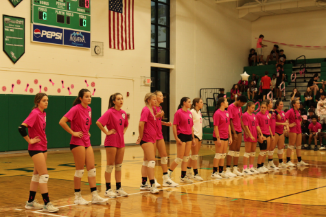 The varsity volleyball team prepares to play in the Cure game.  The Wildcats were victorious, as they topped Madison 3-2.  Varsity captain Maya Webb said about the fundraiser, I love seeing people come together to support such a good cause.