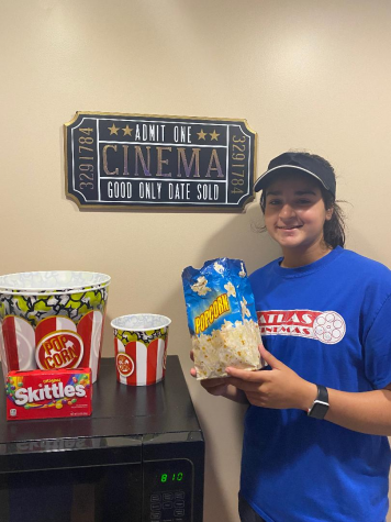 At the concession stand, junior Sarah Karam works another shift at Atlas Cinemas.